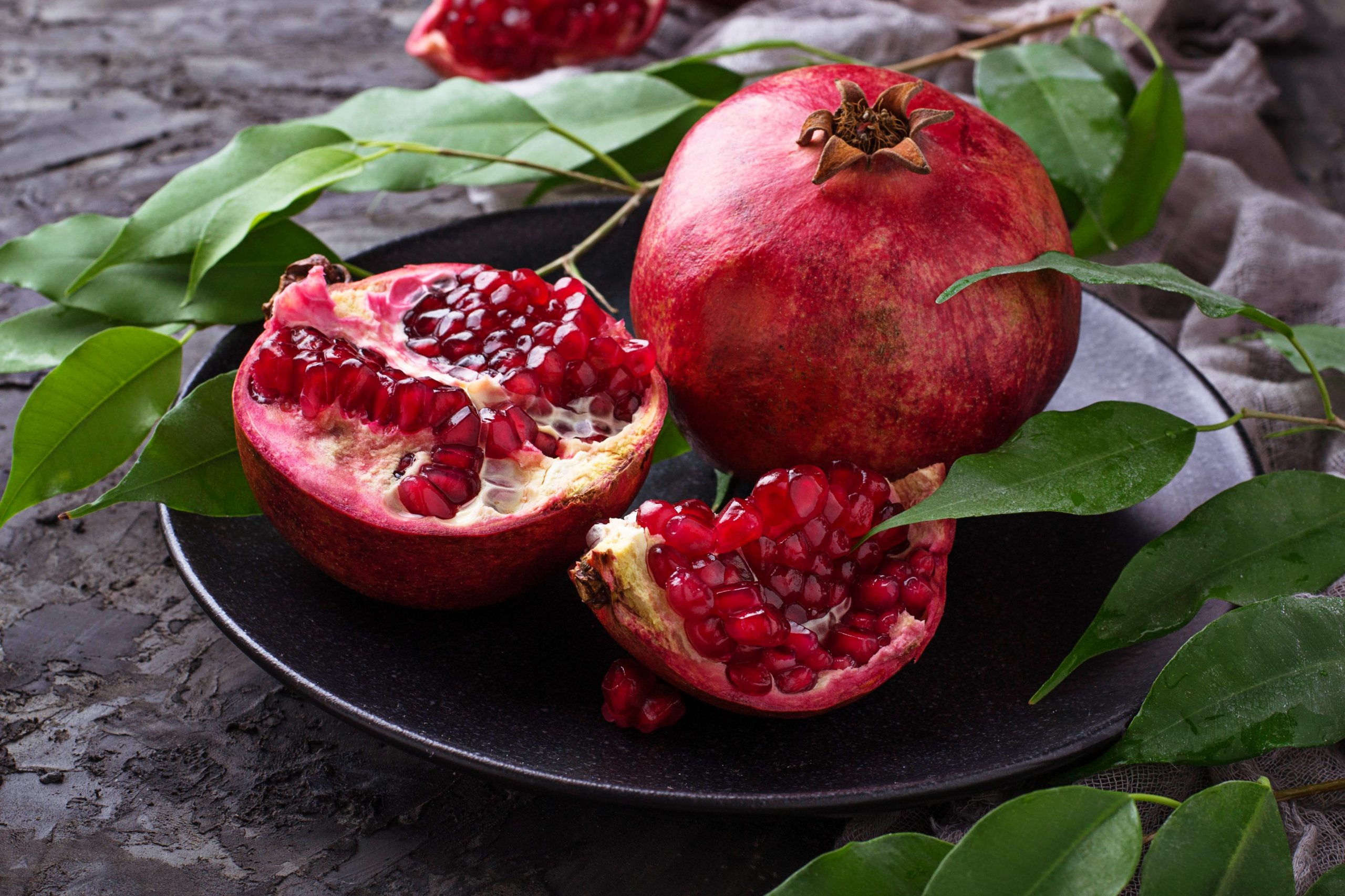 Ripe dissected pomegranates. Selective focus