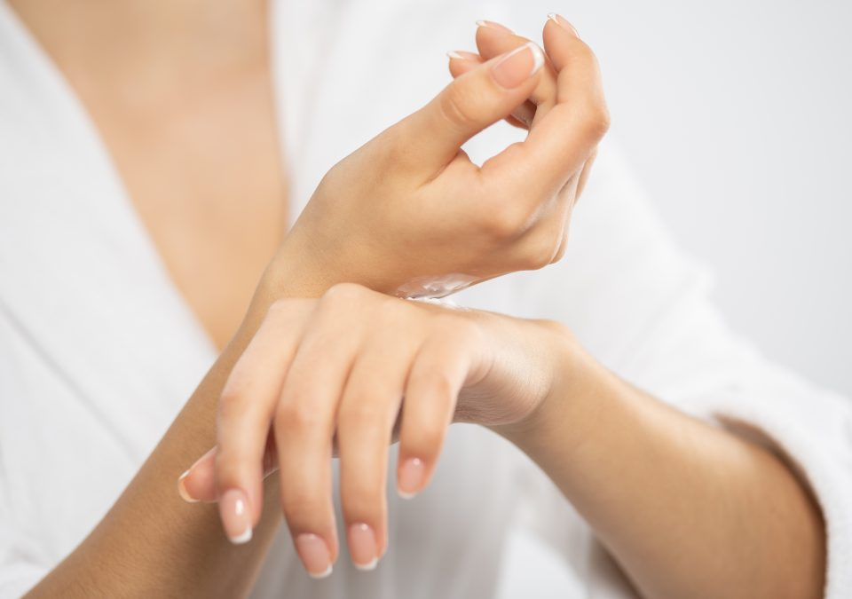 woman-applies-a-cosmetic-moisturizer-on-her-hands-XLC86FQ-1-960x675